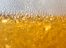 close up image of beer and beer bubbles