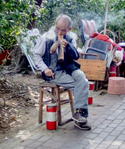 Man smoking huge pipe