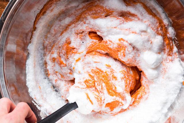 folding egg whites into sweet potatoes for sweet potato souffle recipe