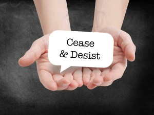 Cease and desist written on a speechbubble