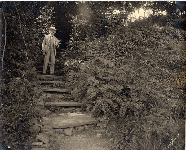 Samuel Clemens standing on the steps leading to his study at Quarry Farm, East Hill, Elmira New York.