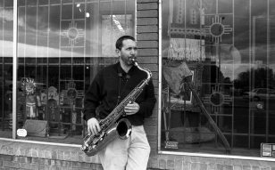 Tom Guralnick -- April 25, 1997 -- Central Avenue, Albuquerque at Morningside Drive -- standing in front of antiques store Cowboys & Indians, which was where Todd Moore worked for a couple years (this store was next door to Outpost Performance Space) -- photo by Mark Weber