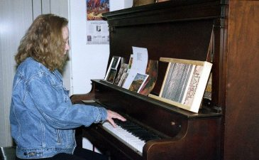 Connie playing my piano -- March 25, 2001 -- Albuquerque -- ontology of the roiling clouds -- photo by Mark Weber