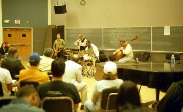 Bobby Bradford Mo'tet -- clinic at University of New Mexico -- April 13, 2004 -- William Jeffrey, drums; Chuck Manning, tenor saxophone; Roberto Miranda, bass -- photo by Mark Weber
