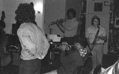 Sunday afternoon jam session at The Little Big Horn -- November 28, 1976 -- Glenn Ferris, trombone (his back to camera); Bobby Bradford, cornet; Roberto Miranda & Richard Rehwald, basses; Vinny Golia, bass clarinet; James Newton, flute -- photo by Mark Weber