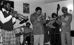 Little Big Horn Sunday afternoon jam session -- October 31, 1976 -- unknown, trumpet, Roberto Miranda, conga; Bobby Bradford, flugelhorn; (Mark Dresser's bass leaning against wall); Richard Rehwald, playing bass; Jimmy Robertson, flute -- photo by Mark Weber