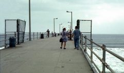Janet and tenor saxophonist Bill Plake on Hermosa Beach pier, California -- this is the pier cheek by jowl next to The Lighthouse -- back when we used to smoke we'd go out on the pier at night between sets of Betty Carter or Art Blakey or Dexter Gordon or Junior Wells & Buddy Guy or Keith Jarrett (w/Dewey Redman, Paul Motion, Haden!) and smoke weed, or whatever -- June 7, 1997 -- photo by Mark Weber