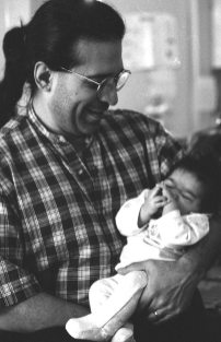Chris Garcia & his daughter Alegria (b.15oct95) -- when they lived in the little house behind Juanitos Tamales in East L.A. -- December 22, 1995 -- photo by Mark Weber
