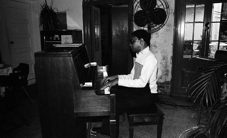 It was just me & James Booker & the fan & that Out of Order Cigarette machine & a few inattentive tourists, one afternoon in the French Quarter -- July 9, 1982 -- Crescent City Cafe, 601 Chartres Street -- I remember James Booker finished directly at 5 o'clock stood straight up and walked right out the door, didn't even grab the green in his tip jar -- a ghost, he disappeared.