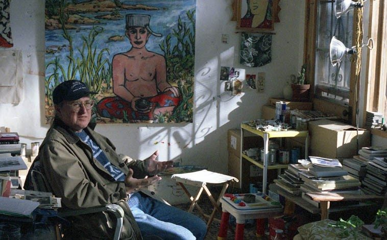 """JB Bryan who did the book design on OTHERWISE, MY LIFE IS ORDINARY for Cinco Puntos Press ---- October 22, 1996 in his studio with his painting """"Johnny Applebuddha"""" -- Alameda, Albuquerque ---- photo by Mark Weber"""