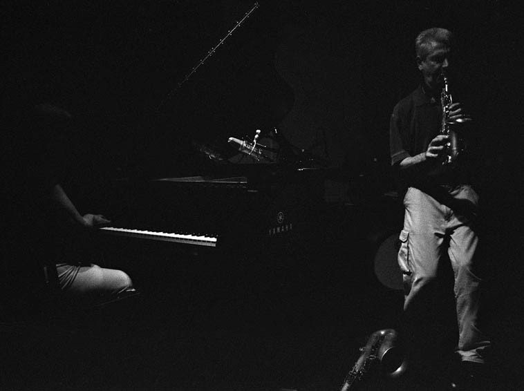 Quartet on August 22, 2o14 at The Stone -- Michael Wimberley, drums; Ken Filiano, bass; Connie Crothers, piano; Louis Belogenis, soprano & tenor saxophones -- photo by Mark Weber -- I have not been following  very closely of late this particular line of saxophone music and was unprepared to hear the degree to how  much development and refinement had transpired in my absence -- I was knocked out ---- In as much as a jazz band is a cooperative effort with all hands on deck, all as equal participants, it was how the saxophonist  built his solo with logical gradual layering of phrases unhurried methodical with rhythm section adding  and building (Ken even using some loop effects at one point), constructing and building toward a lion's roar  inflating the saxophone until the rivets burst the seams more layers that built and insistent toward  exultation and complete full-roaring gale force winds -- CC later told me that she really dug playing with Michael Wimberley on this set, and Ken was a tour de force