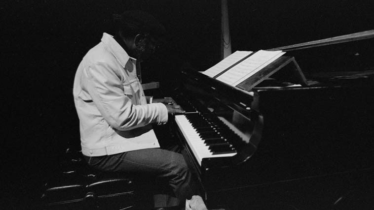 John kept a spinet at home in his living room but here he is on grand piano during a break at the soundcheck  for the Vinny Golia Large Ensemble at UCLA Schoenberg Hall -- March 14, 1982 -- photo by Mark Weber