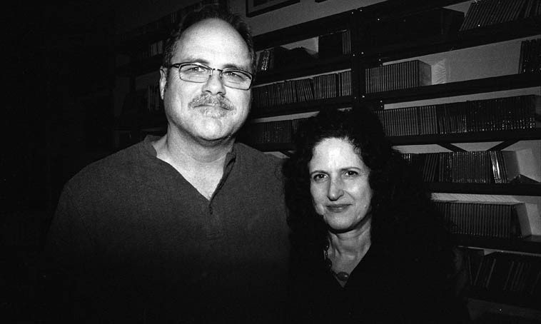 """George McMullen with Carol Liebowitz --  November 16, 2o14 -- Talk about 6-degrees of  separation!  I know George from Los Angeles, mostly because we're both close friends  with the great tenor player Bill Plake, SO, when I heard him introduce himself over our dinner plates, I  thought to myself How many trombonists could there be named George McMullen, so I asked Are you  from Los Angeles and he said Yes, that he'd just moved to Riverdale three weeks ago -- So, I introduced  myself -- it turns out Carol met him on a train: """"Coming home from a session in Brooklyn on Halloween night… We were in a crowded subway car with many costumed partygoers, and struck up a conversation…""""  [email from CL 22dec2o14] -- photo by Mark Weber"""