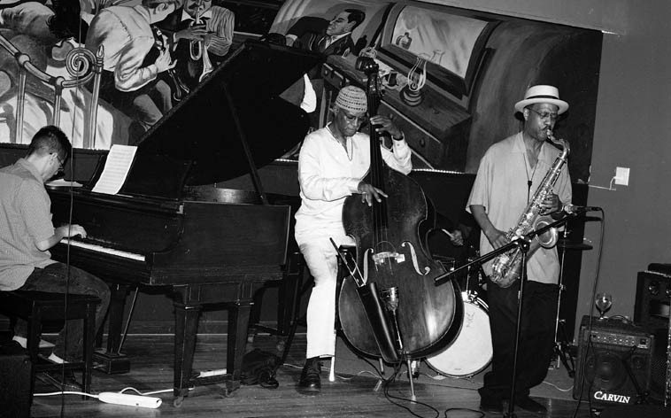 Patience Higgins Sugar Hill Quartet -- September 6, 2oo6 -- Minton's Playhouse, 208 W. 118th Street,  Harlem NYC -- Marcus Persiani, piano; Dave Gibson, drums; Andy McLeod III, bass; Patience Higgins,  tenor saxophone ---- photo by Mark Weber ---- original 1948 mural by Charles Graham