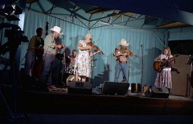 Bayou Seco at the Albuquerque Museum -- June 13, 1996 -- Terry Bluhm, bass, Jefferson  Voorhees, drums; Scott Mathis, mandolin; Linda Askew, guitar; Ken & Jeanie . . . . .  photo by Mark Weber ---- Jeanie is one of the few singers that could get by without  a microphone in a pinch, I'm not saying she's loud or a yeller,  I'm saying she has a  naturally resonant voice that can fill a room with her smokey burnished vocal cords