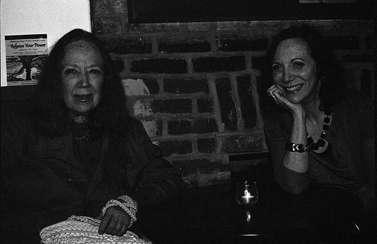 Connie and Andrea -- May 8, 2o15 -- photo by Mark Weber ---- Andrea can sing it all: From Broadway  show tunes to free-association spontaneous improvised sky songs. From the Great American Song  Book to the Book of Imagistes.  (Sky songs are what delta blues rambler Bukka White called the  songs he pulled out of the air.)
