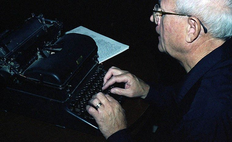 Todd Moore with his father's old typewriter -- October 23, 1994 (Todd used this typewriter from 1953 onward . . . . ) -- photo by Mark Weber