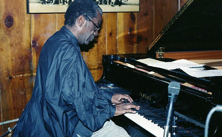 Andrew Hill -- September 1, 1996 at Sweet Basil (7th & Bleecker) NYC ---- We sat at one of the front tables and I got to watch his fingers all night playing with his quartet (Rufus Reid, Bennie Maupin, Pheeroan AkLaff) Andrew Hill had a hesitant manner in placing his chords, he'd hover over the keys and only drop the chord in at the most oblique spots where it could float and drift with the mists---- photo by Mark Weber