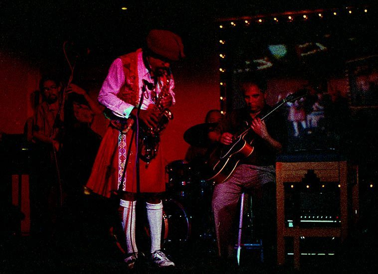Rufus Harley, the jazz bagpiper in New Mexico -- Rufus has made records with Sonny Rollins, Herbie Mann, Sonny Stitt, and several records of his own on Atlantic ---- This quartet: Justin Bransford, bass; Pete Amahl, drums; Tony Cesarano, guitar -- May 27, 1998 photo by Mark Weber