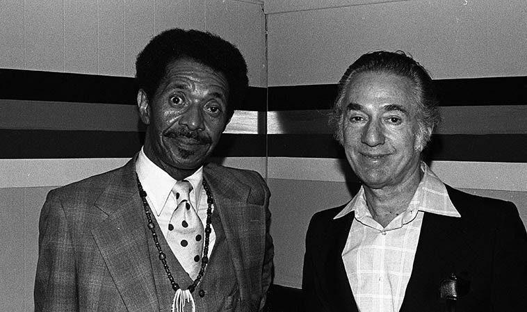 Philly Joe Jones and Leonard Feather at Donte's -- April 9, 1980 -- photo by Mark Weber -- It was the devil in me that orchestrated this photo -- Philly Joe's quartet was on break, and I had asked him if I could take his picture, and just at that moment Leonard Feather was walking by and I said Hey Leonard stand with Philly Joe! -- (Leonard was not very well liked in those days -- despite all of the great work he did in jazz journalism he had a weird quirk of slanting things pejoratively in his L.A. TIMES jazz column) -- So, that explains Philly Joe's look, he was telling me with his eyes that he's going to kill me after this shot (I still think Feather's less than 500-word analysis of Supersax on their first album is the most succinct explanation of that marvelous band's work)