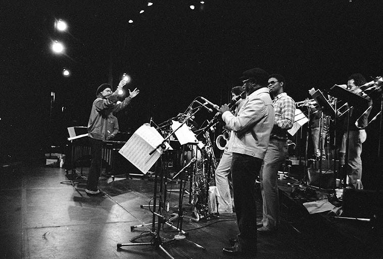 Wayne Peet conducting the Vinny Golia Large Ensemble -- March 14, 1982 at UCLA Schoenberg Hall rehearsal for performance that night -- photo by Mark Weber -- (John Carter on clarinet is in foreground)