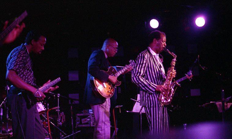 Ornette Coleman & Primetime -- June 27, 1986 at Wolfgang's, Columbus Avenue, San Francisco -- Charles Ellerbee & Bern Nix (guitars), Jamaaladeen Tacuma & Al MacDowell basses) -- photo by Mark Weber