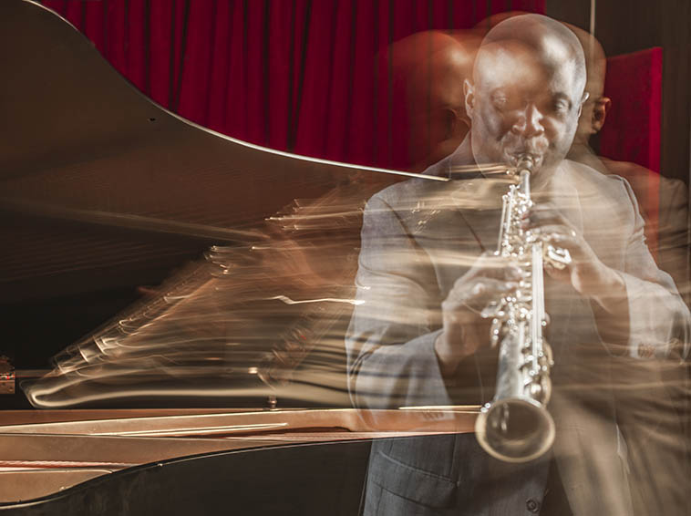 "Sam Newsome is married to Meg Okura and is on staff at Long Island University, Brooklyn, in the music department, and a well-known New York soprano saxophonist ------------- His latest CD release SOPRANOVILLE reveals his studies into prepared soprano (think John Cage and his prepared pianos) thus, Sam will be bringing his horns to play LIVE, always the best way to explain anything --------- We greatly look forward to his return to the KUNM studios (his previous visit to the Thursday jazz show was with Brooklyn Saxophone Quartet on April 7, 2005 w/ Fred Ho(baritone), John O'Gallagher(alto), David Bindman(tenor), Sam(soprano))----When you get a minute, check out Sam's intelligence at his on-line music journal (I'm not overly fond of the term ""blog"") .Photo of Sam Newsome taken by Salvatore Corso -- July 3, 2o17"