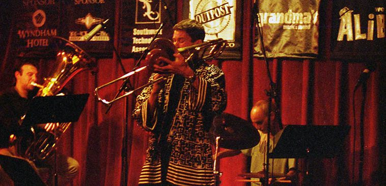 Ray Anderson Pocket Brass in Albuquerque -- October 11 or 12, 1999 -- photo by Mark Weber ---- Ray(trombone), Johnny Vidacovich(drums), Joseph Davila(tuba), Eddie Allen(trumpet), Outpost Performance Space ------ I think there's a recording of these two concerts floating around somewhere, whew, it was good