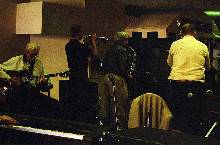 Local Albuquerque outfit known as Jazz a la Carte -- And that's the legendary Clyde Hankins on guitar, with Dick Trask(alto), Dick Rock(trombone), and my guess is that's Kent Erickson on flugel (for some reason I didn't make a note, but Kent was the regular trumpeter in this band) -- October 10, 1999 -- photo by Mark Weber -------- of Clyde's many accomplishments are the years in L.A. he played with Johnny Richards, he got away from us in 2006 (Johnny Richards was the guy who wrote Kenton's masterpiece CUBAN FIRE! (1956))
