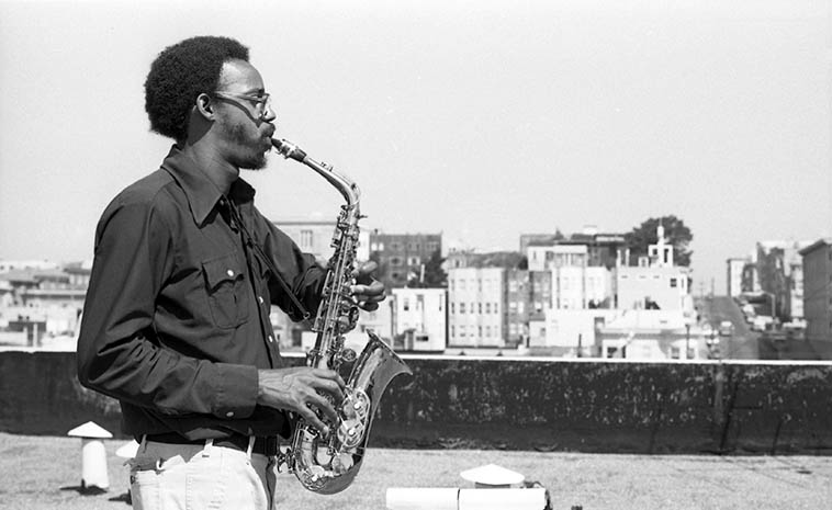 Lewis Jordan and San Francisco -- on the roof of his apartment building in the Haight -- September 1, 1978 (before we tripped over to KPOO) -- photo by Mark Weber ----- Lewis has a long-awaited new cd THIS IS WHERE I CAME IN (www.musicatlarge.org) that we will be spinning in much of the near future