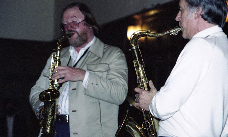 Gary Foster & Warne Marsh -- April 28, 1977 Cal Tech, Pasadena -- photo by Mark Weber ---- I believe I've said this before at JFM and I've certainly voiced it on the radio, and that is that this particular thing we call poetry visits moreso in music than in poetry ---- Why? Is it because words are an adaption, a layering upon consciousness that is an impermeable barrier to the deeper consciousness? (see my upcoming essay on Word Virus) ---- Music, and painting, and dance, and cinema occasionally, all get to that place more readily, especially music. Poetry has the name and the reputation but comes in dead last in the arts ---- call it gravitas or pre-rational introspection, elegance, thoughts frozen in time, sublimity . . . .