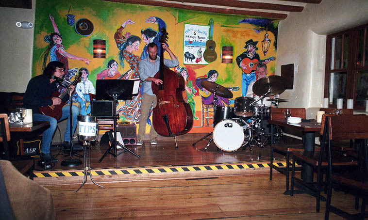 Pat Malone Trio ---- Pat is one of my favorite guitarists, among many in New Mexico, absolutely free as the popcorn clouds ----- This is one of his regular spots in Santa Fe: El Farol (built 1835) on Canyon Road -- w/ Colin Deuble(bass) and Cal Haines(DW drums) -- February 18, 2o18 (Cal's birthday) -- photo by Mark Weber -- the place looks empty, but that's because I knew to take some shots before the place filled up