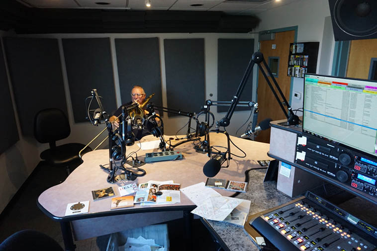 That's what KUNM control room looks like when a trombonist is playing in it ----- Michael Vlatkovich from Los Angeles on one of his many visits to KUNM – June 21, 2o18 – photo by Mark Weber