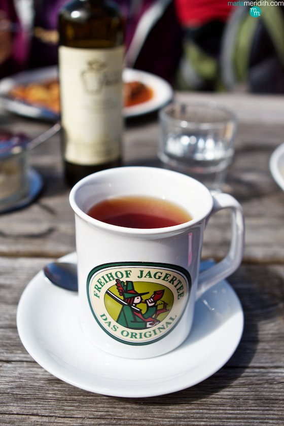 Treat yourself to a Jägertee, a regional specialty in the Italian Dolomites. This Austrian drink is an alcoholic beverage made by mixing overproof rum (yum) with black tea, red wine, plum brandy, orange juice and various spices, It's sweet & warming on chilly days. MarlaMeridith.com ( @marlameridith )