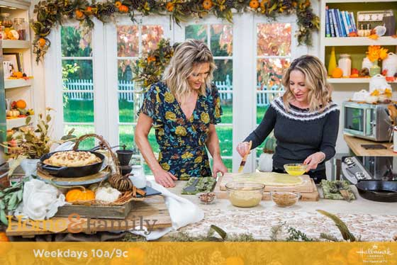 """Debbie Matenopoulos and Cameron Mathison welcome """"High Alpine Cuisine"""" author, Marla Meridith whips up cast-iron skillet cinnamon rolls with maple pumpkin cream cheese frosting. Credit: © 2018 Crown Media United States, LLC 