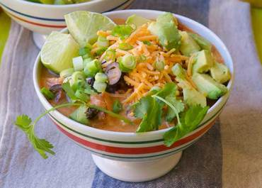 Make a batch of this soul warming Chipotle Chicken Tortilla Soup recipe, a hearty, delicious meal for the entire family. MarlaMeridith.com