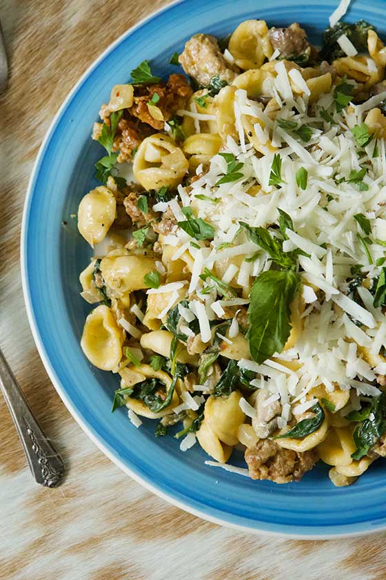 Make this recipe for delicious Orecchiette with Sausage, Mushrooms & Spinach and your family will swoon over it! No need for Italian take-out when you can cook this dish easily at home. MarlaMeridith.com