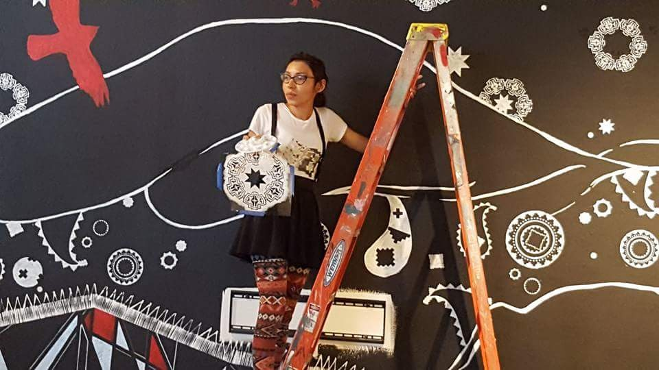 The Great Race Mural at Intermedia Arts | Marlena Myles painting a mural