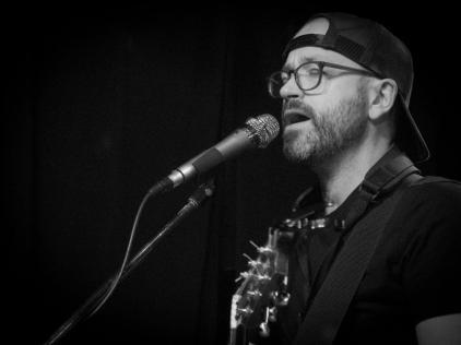Trevor Ras singing at Skylark Cafe