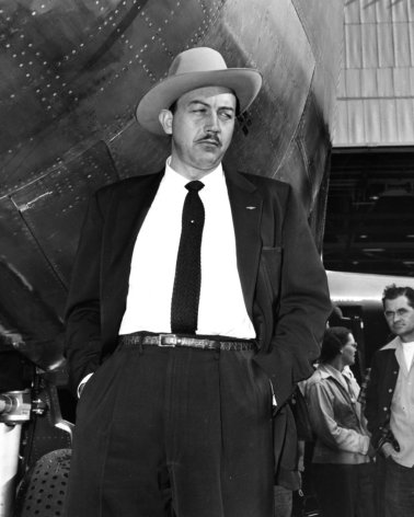 "In this image taken circa 1954, Boeing test pilot Alvin M. ""Tex"" Johnston in the Stetson hat he liked to wear. Along with his cowboy style of dress, his maverick behavior is said to have inspired the creation of Dr. Strangelove's Maj. T.J. ""King"" Kong character, who, in rodeo style, rode a balky nuclear weapon to its target."