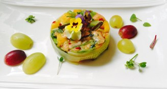 Salmon tartare with chilli, spring onion and grapes