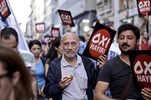 "Turkish leftist people marched with placards reading ""NO"" in solidarity with Greek people on July 4, 2015 at the Istiklal avenue in Istanbul, on the eve of the Greek referendum on its bailout terms. Nearly 10 million Greek voters will take to the ballot booths on July 5 to vote 'Yes' or 'No' in a referendum asking if they accept more austerity measures in return for bailout funds. AFP PHOTO / OZAN KOSE"