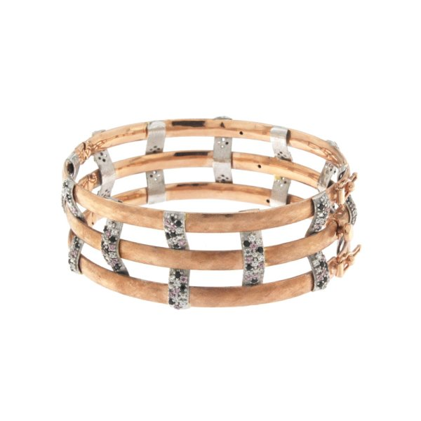 Rigid bracelet in rose and white gold with zircons.