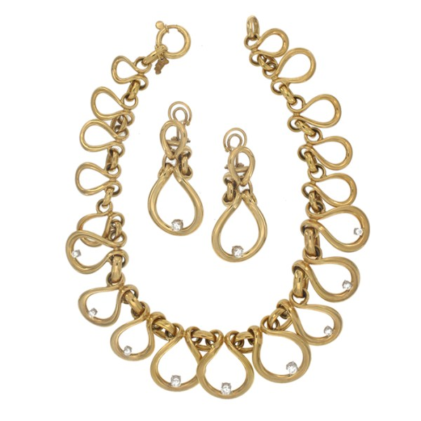 Necklace and earrings in yellow gold with zircons