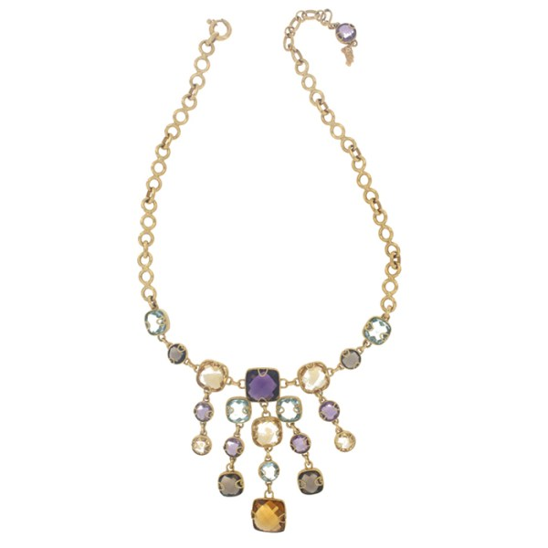 Necklace and earrings in yellow gold with stones