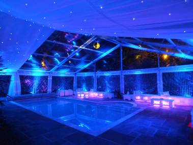 marqee-over-swimming-pool-with-blue-lights-and-ivory-starlight