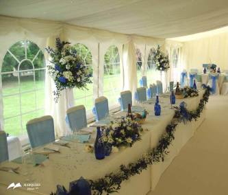 Interior cream and floral wedding marquee