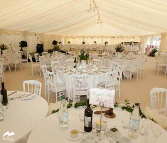 Image of ruched lining marquee and chandeliers