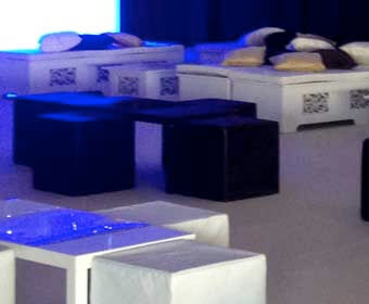 Image of white ornate island with black cube seating