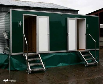 Image of raised portable toilets with steps leading to each stall